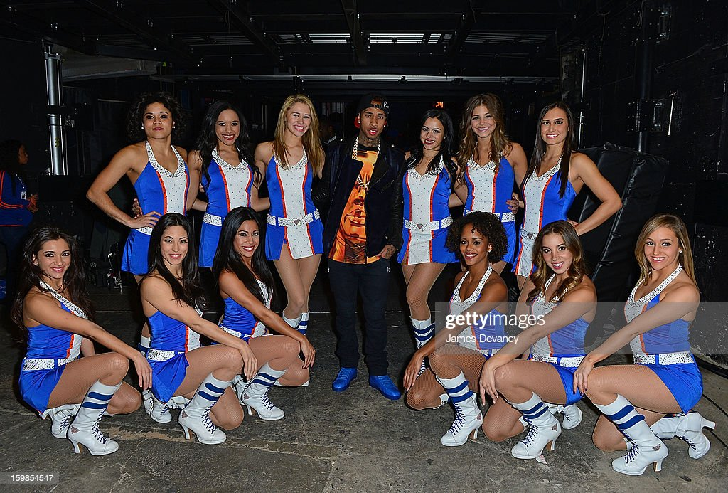 <a gi-track='captionPersonalityLinkClicked' href=/galleries/search?phrase=Tyga&family=editorial&specificpeople=4489457 ng-click='$event.stopPropagation()'>Tyga</a> poses with the Knicks City Dancers wearing his Reebok T-Raww's at the Brooklyn Nets vs New York Knicks game at Madison Square Garden on January 21, 2013 in New York City.