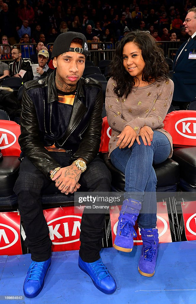 <a gi-track='captionPersonalityLinkClicked' href=/galleries/search?phrase=Tyga&family=editorial&specificpeople=4489457 ng-click='$event.stopPropagation()'>Tyga</a> sits courtside with <a gi-track='captionPersonalityLinkClicked' href=/galleries/search?phrase=Angela+Yee&family=editorial&specificpeople=4443054 ng-click='$event.stopPropagation()'>Angela Yee</a> wearing his Reebok T-Raww's before the Brooklyn Nets vs New York Knicks game at Madison Square Garden on January 21, 2013 in New York City.