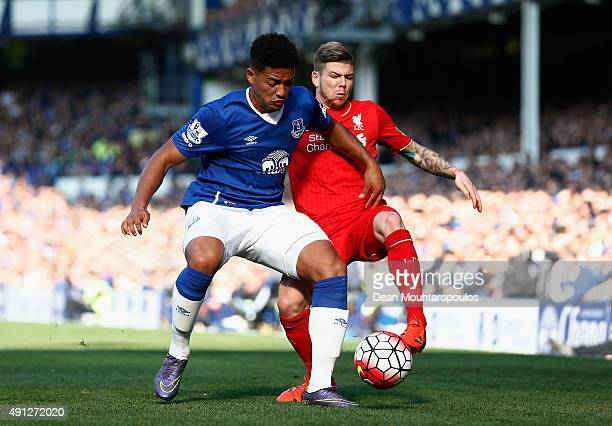 Tyias Browning of Everton and Alberto Moreno of Liverpool in action during the Barclays Premier League match between Everton and Liverpool at...