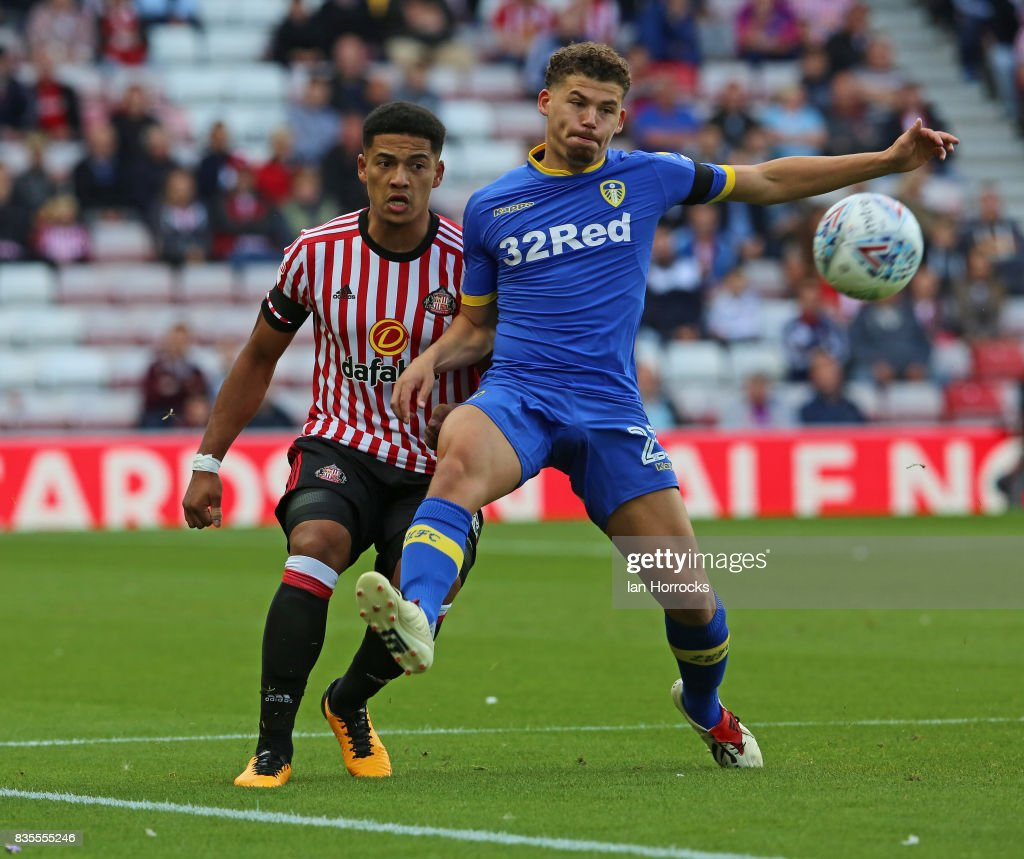 Tyias Browning of Sunderland (L) takes on Kalvin Philips of Leeds during the Sky Bet Championship match between Sunderland and Leeds United at Stadium of Light on August 19, 2017 in Sunderland, England.