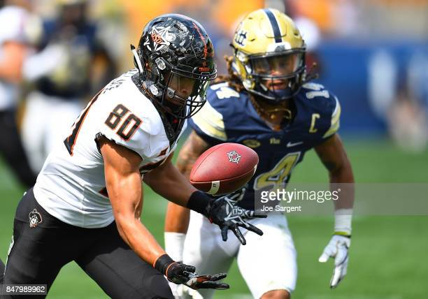 Tylan Wallace of the Oklahoma State Cowboys makes a catch in front of Avonte Maddox of the Pittsburgh Panthers during the fourth quarter at Heinz...
