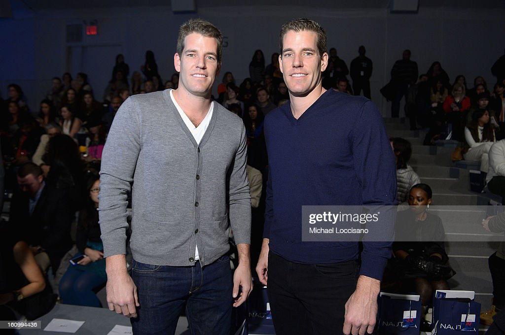 Tyler and Cameron Winklevoss attend the Nautica Men's Fall 2013 fashion show during Mercedes-Benz Fashion Week at The Stage at Lincoln Center on February 8, 2013 in New York City.