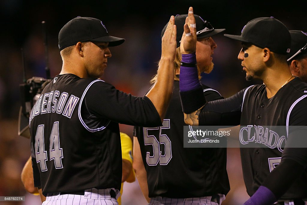 Tyler Anderson #44 of the Colorado Rockies celebrates the win against the Philadelphia Phillies with Carlos Gonzalez #5 at Coors Field on July 9, 2016 in Denver, Colorado. The Rockies defeated the Phillies 8-3.