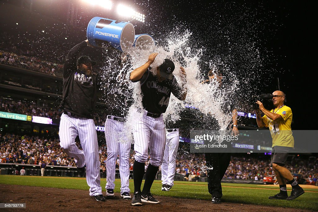 Tyler Anderson of the Colorado Rockies gets a shower from teammates Jason Motte and Brandon Barnes after leading the team to the win against the...