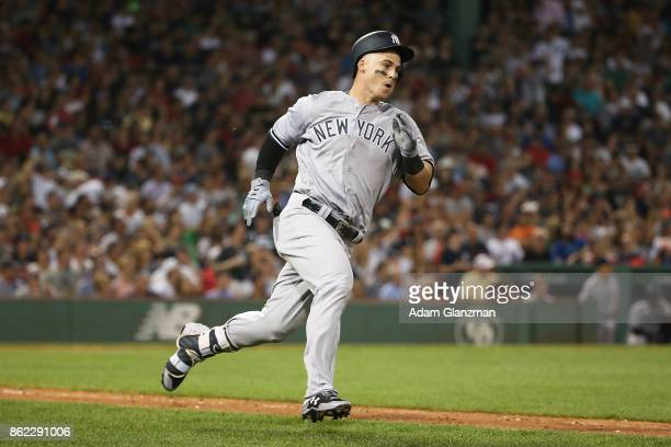 Tyler Austin of the New York Yankees runs to first base in the eighth inning of a game against the Boston Red Sox at Fenway Park on August 19 2017 in...