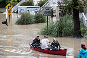 Tyler Bahnmuller Matt Talley and Will Brennan take a canoe to investigate their homes following flooding in the area October 5 2015 in Columbia South...