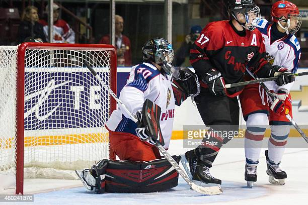 Tyler Benson of Canada Black battles for the puck against Russia during the World Under17 Hockey Challenge on November 2 2014 at the RBC Centre in...