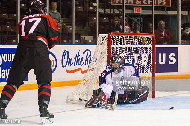 Tyler Benson of Canada Black fires the puck against Vladislav Sukhachyov of Russia during the World Under17 Hockey Challenge on November 2 2014 at...