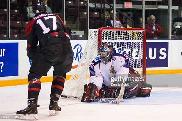 Tyler Benson of Canada Black moves the puck against Vladislav Sukhachyov of Russia during the World Under17 Hockey Challenge on November 2 2014 at...