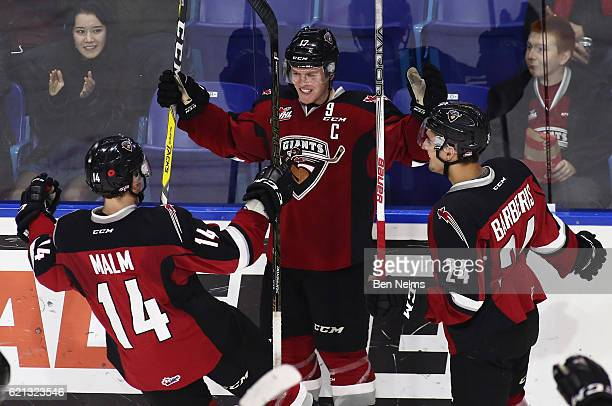 Tyler Benson of the Vancouver Giants celebrates his goal against the Lethbridge Hurricanes with teammates James Malm and Matt Barberis during the...