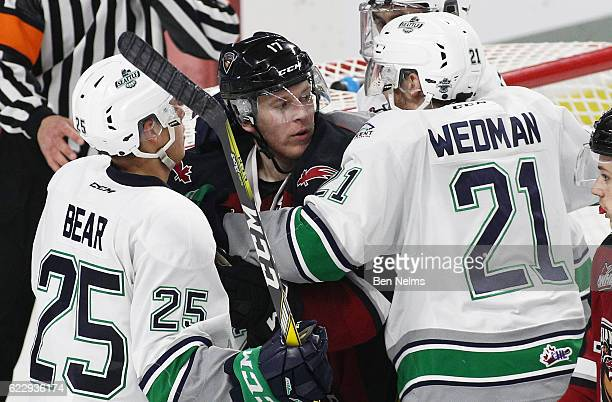 Tyler Benson of the Vancouver Giants is grabbed by Matthew Wedman and Ethan Bear of the Seattle Thunderbirds during the second period of their WHL...
