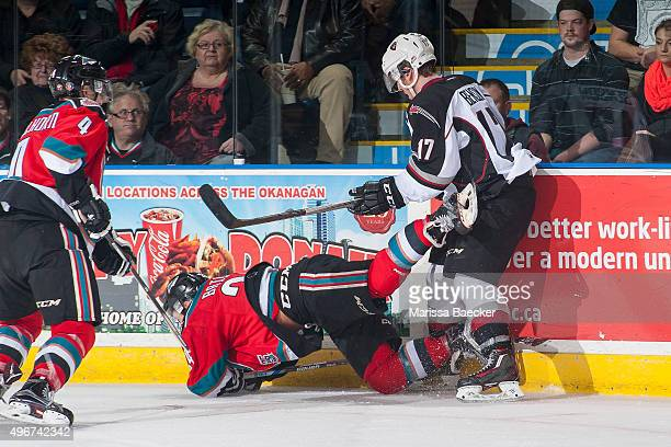 Tyler Benson of Vancouver Giants back checks Tyson Baillie of Kelowna Rockets to the ice during second period on November 11 2015 at Prospera Place...
