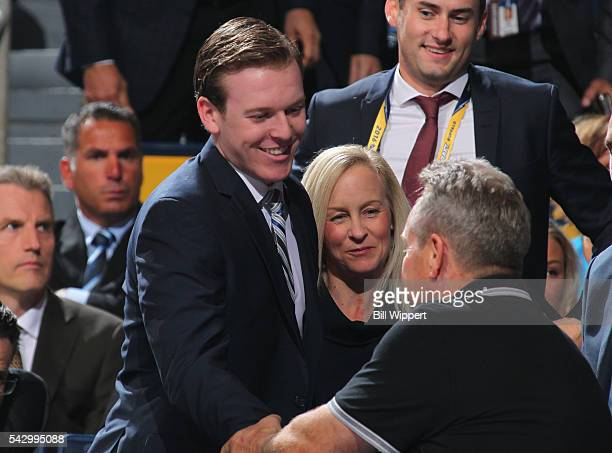 Tyler Benson reacts with his family after being selected 32nd overall by the Edmonton Oilers during the 2016 NHL Draft at First Niagara Center on...