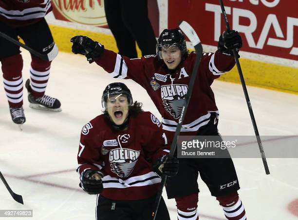 Tyler Bertuzzi of the Guelph Storm celebrates his goal at 223 of the second period against the London Knights along with Zack Mitchell during the...