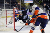 Tyler Beskorowany of the St John's IceCaps looks to make a save during an American Hockey League game against the Bridgeport Sound Tigers on March 22...