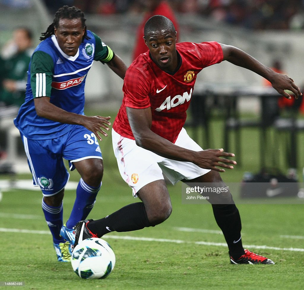 Tyler Blackett of Manchester United clashes with Tsweu Piet Mokoro of AmaZulu FC during the pre-season friendly between AmaZulu FC and Manchester United at Moses Mabhida Stadium on July 18, 2012 in Durban, South Africa.