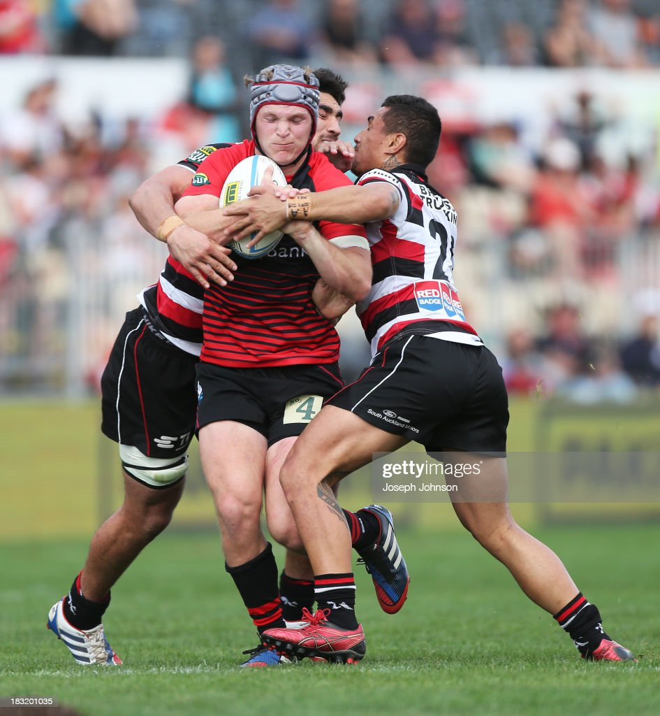 Tyler Bleyendaal of Canterbury with the ball in the tackle of Lucky Palamo and Johnny Kawau of Counties Manukau during the round eight ITM Cup match between Cantebury and Counties Manukau at AMI Stadium on October 6, 2013 in Christchurch, New Zealand.