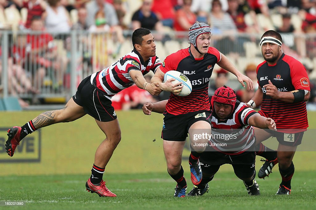 Tyler Bleyendaal of Canterbury with the ball in the tackle of Lucky Palamo and Attila Va'a of Counties Manukau during the round eight ITM Cup match between Cantebury and Counties Manukau at AMI Stadium on October 6, 2013 in Christchurch, New Zealand.