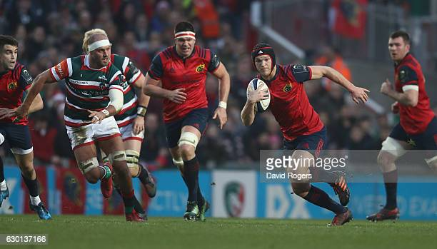 Tyler Bleyendaal of Munster breaks with the ball during the European Rugby Champions Cup match between Leicester Tigers and Munster at Welford Road...
