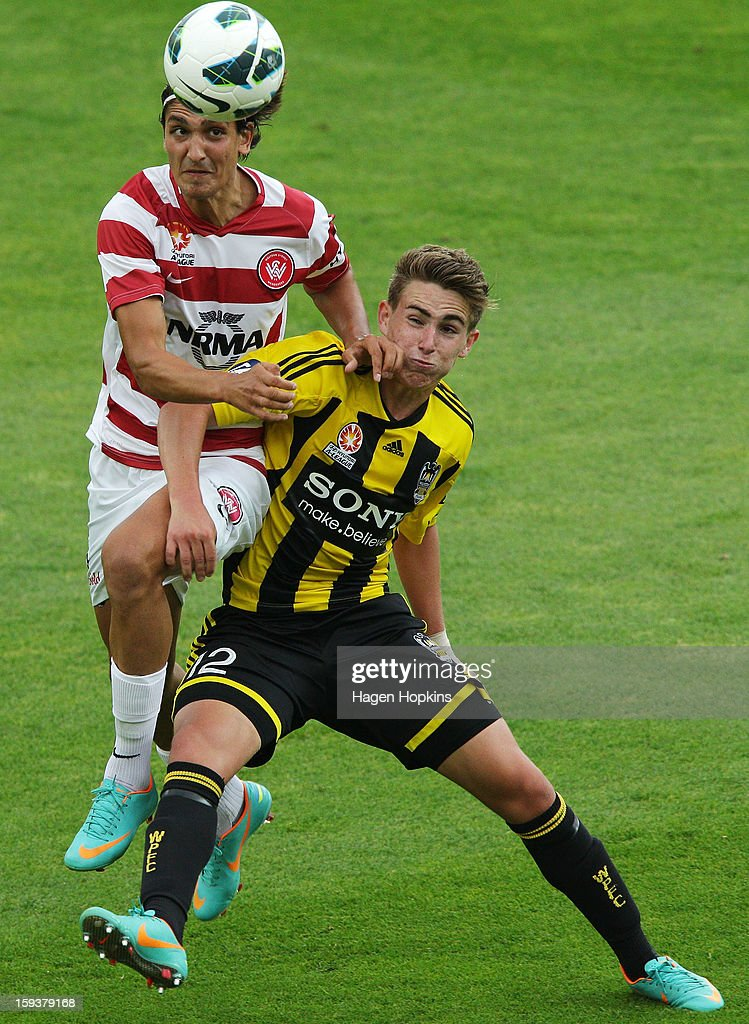 Tyler Boyd of the Phoenix and Jerome Polenz of the Wanderers challenge for the ball during the round 16 A-League match between the Wellington Phoenix and the Western Sydney Wanderers at Westpac Stadium on January 13, 2013 in Wellington, New Zealand.