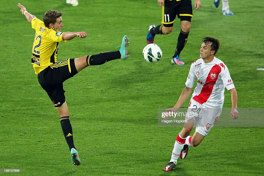 Tyler Boyd of the Phoenix attempts to control a loose ball while Sam Mitchinson (Rof the Heart looks on during the round 13 A-League match between the Wellington Phoenix and the Melbourne Heart at Westpac Stadium on December 27, 2012 in Wellington, New Zealand.