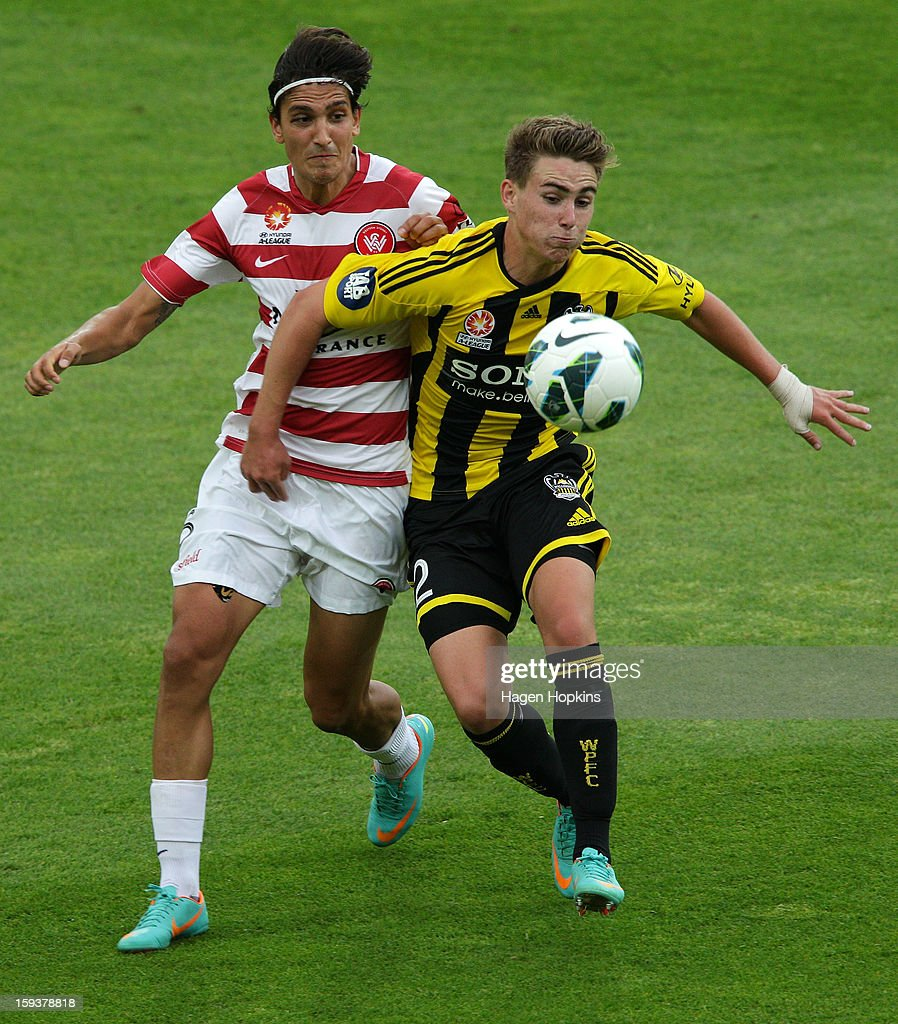 Tyler Boyd of the Phoenix controls the ball under pressure from Jerome Polenz of the Wanderers during the round 16 A-League match between the Wellington Phoenix and the Western Sydney Wanderers at Westpac Stadium on January 13, 2013 in Wellington, New Zealand.