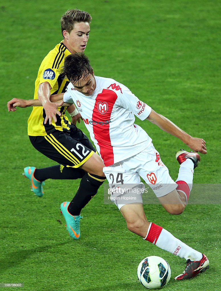 Tyler Boyd of the Phoenix defends against Sam Mitchinson (R) of the Heart during the round 13 A-League match between the Wellington Phoenix and the Melbourne Heart at Westpac Stadium on December 27, 2012 in Wellington, New Zealand.