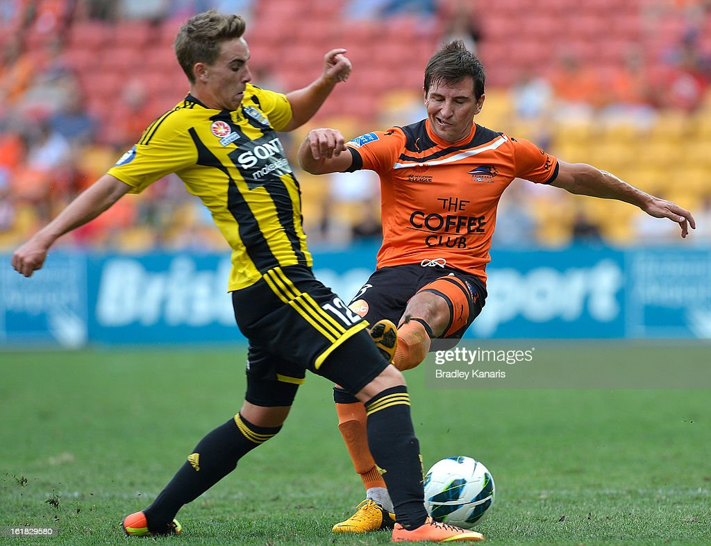 Tyler Boyd of the Phoenix is challenged by Shane Stefunutto of the Roar during the round 21 A-League match between the Brisbane Roar and the Wellington Phoenix at Suncorp Stadium on February 17, 2013 in Brisbane, Australia.