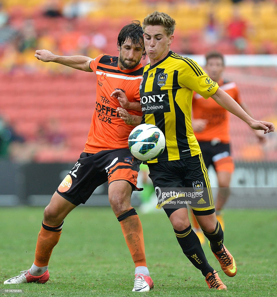 Tyler Boyd of the Phoenix is challenged by Thomas Broich of the Roar during the round 21 A-League match between the Brisbane Roar and the Wellington Phoenix at Suncorp Stadium on February 17, 2013 in Brisbane, Australia.