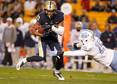 Tyler Boyd of the Pittsburgh Panthers runs after making a catch in the first half during the game against Donnie Miles of the North Carolina Tar...