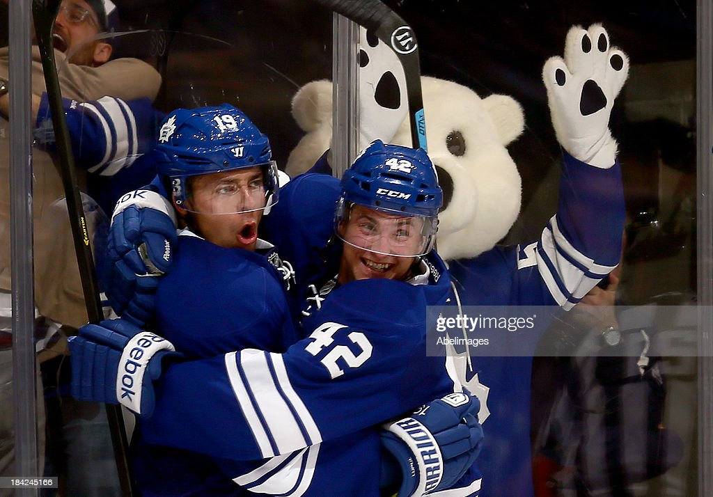<a gi-track='captionPersonalityLinkClicked' href=/galleries/search?phrase=Tyler+Bozak&family=editorial&specificpeople=6183313 ng-click='$event.stopPropagation()'>Tyler Bozak</a> #42 and <a gi-track='captionPersonalityLinkClicked' href=/galleries/search?phrase=Joffrey+Lupul&family=editorial&specificpeople=206995 ng-click='$event.stopPropagation()'>Joffrey Lupul</a> #19 of the Toronto Maple Leafs celebrate <a gi-track='captionPersonalityLinkClicked' href=/galleries/search?phrase=Joffrey+Lupul&family=editorial&specificpeople=206995 ng-click='$event.stopPropagation()'>Joffrey Lupul</a>'s goal against the Edmonton Oilers during NHL action at the Air Canada Centre October 12, 2013 in Toronto, Ontario, Canada.