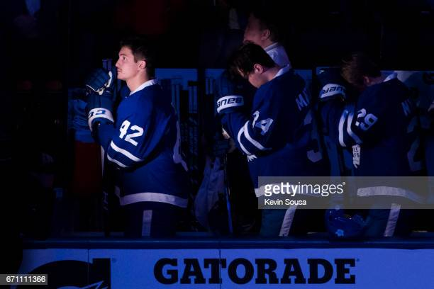 Tyler Bozak Auston Matthews and William Nylander of the Toronto Maple Leafs during the national anthem prior to Game Four of the Eastern Conference...