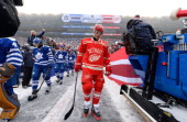 Tyler Bozak Carl Gunnarsson and David Clarkson of the Toronto Maple Leafs and Daniel Cleary of the Detroit Red Wings make their way to the ice...