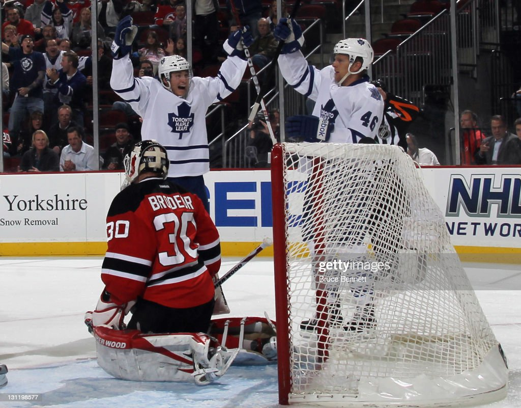 Tyler Bozak celebrates a score by Joey Crabb of the Toronto Maple Leafs at 837 of the first period against Martin Brodeur of the New Jersey Devils at...