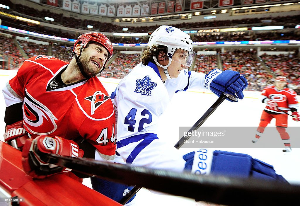 <a gi-track='captionPersonalityLinkClicked' href=/galleries/search?phrase=Tyler+Bozak&family=editorial&specificpeople=6183313 ng-click='$event.stopPropagation()'>Tyler Bozak</a> #42 of the Toronto Maple checks Jay Harrison #44 of the Carolina Hurricanes during play at PNC Arena on February 14, 2013 in Raleigh, North Carolina.