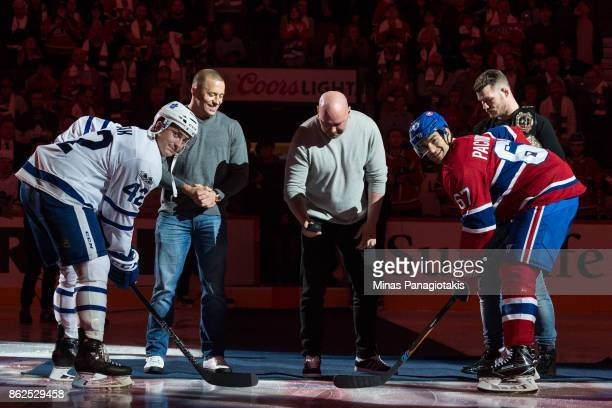 Tyler Bozak of the Toronto Maple Leafs and Max Pacioretty of the Montreal Canadiens join the president of the UFC Dana White Georges StPierre and UFC...