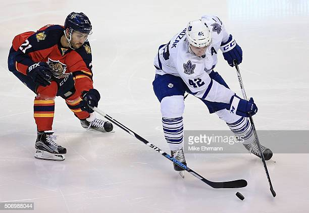 Tyler Bozak of the Toronto Maple Leafs and Vincent Trocheck of the Florida Panthers fight for the puck during a game at BBT Center on January 26 2016...