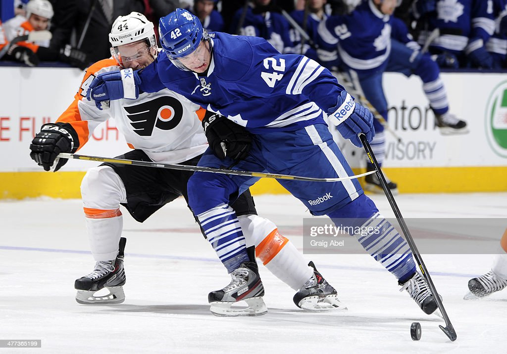 <a gi-track='captionPersonalityLinkClicked' href=/galleries/search?phrase=Tyler+Bozak&family=editorial&specificpeople=6183313 ng-click='$event.stopPropagation()'>Tyler Bozak</a> #42 of the Toronto Maple Leafs battles for the puck with <a gi-track='captionPersonalityLinkClicked' href=/galleries/search?phrase=Kimmo+Timonen&family=editorial&specificpeople=201521 ng-click='$event.stopPropagation()'>Kimmo Timonen</a> #44 of the Philadelphia Flyers during NHL game action March 8, 2014 at the Air Canada Centre in Toronto, Ontario, Canada.