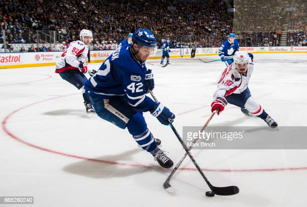Tyler Bozak of the Toronto Maple Leafs battles for the puck with Marcus Johansson of the Washington Capitals during the third period at the Air...