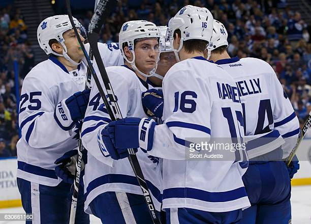 Tyler Bozak of the Toronto Maple Leafs celebrates his goal with teammates James van Riemsdyk and Mitchell Marner during second period against the...