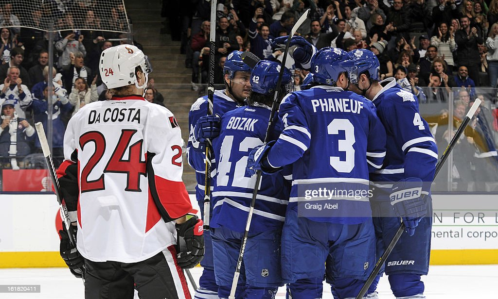 Tyler Bozak #42 of the Toronto Maple Leafs celebrates his third period goal with teammates as Stephane Da Costa #24 of the Ottawa Senators looks on during NHL game action February 16, 2013 at the Air Canada Centre in Toronto, Ontario, Canada.