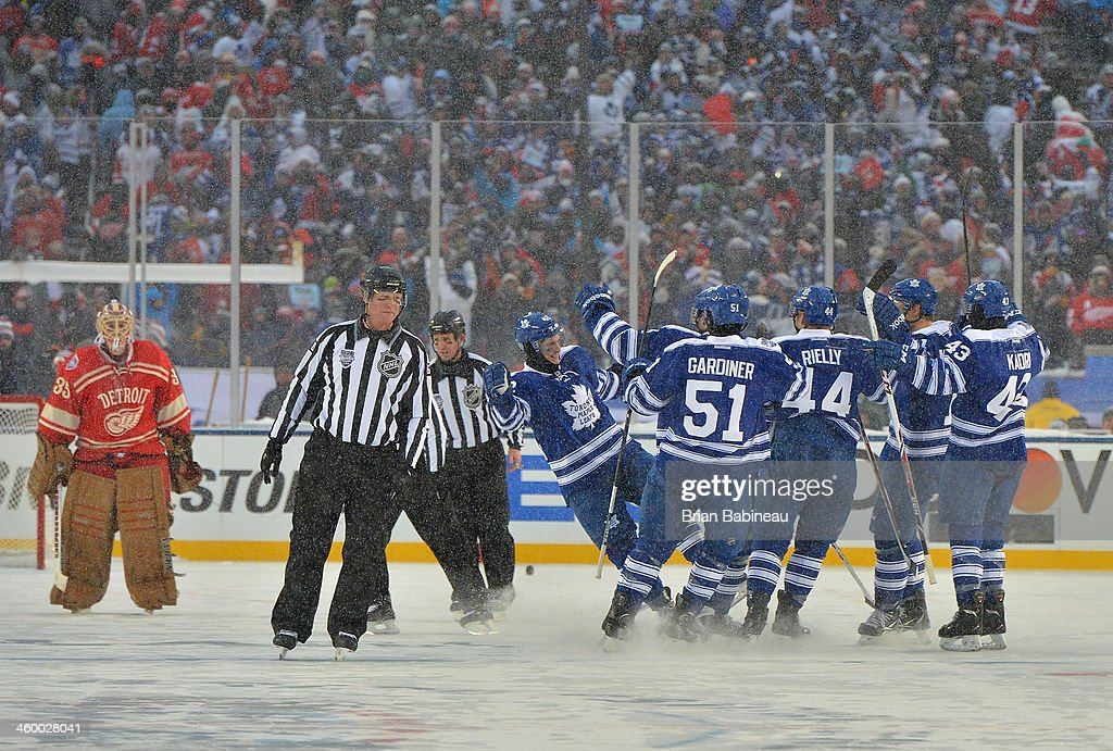 <a gi-track='captionPersonalityLinkClicked' href=/galleries/search?phrase=Tyler+Bozak&family=editorial&specificpeople=6183313 ng-click='$event.stopPropagation()'>Tyler Bozak</a> #42 of the Toronto Maple Leafs celebrates with his teammates after scoring on goaltender <a gi-track='captionPersonalityLinkClicked' href=/galleries/search?phrase=Jimmy+Howard&family=editorial&specificpeople=2118637 ng-click='$event.stopPropagation()'>Jimmy Howard</a> #35 of the Detroit Red Wings during shootout overtime of the 2014 Bridgestone NHL Winter Classic on January 1, 2014 at Michigan Stadium in Ann Arbor, Michigan. Bozak scored on his shootout attempt for the win against the Detroit Red Wings. The Maple Leafs defeated the Red Wings 3-2 in shootout overtime.