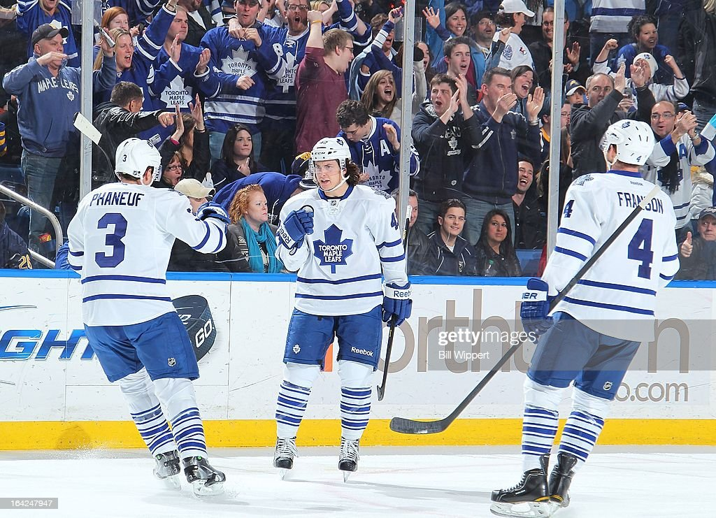 Tyler Bozak #42 of the Toronto Maple Leafs celebtrates his first-period goal against the Buffalo Sabres with teammates Dion Phaneuf #3 and Cody Franzen #4 on March 21, 2013 at the First Niagara Center in Buffalo, New York.