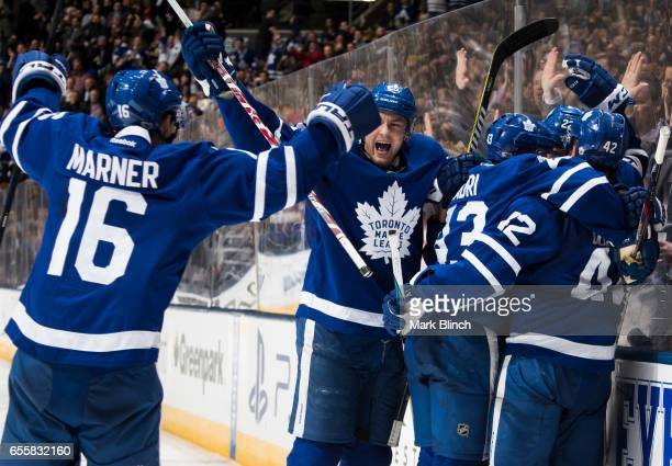 Tyler Bozak of the Toronto Maple Leafs is mobbed by teammates Nikita Zaitsev Nazem Kadri James van Riemsdyk and Mitch Marner after he scored on the...