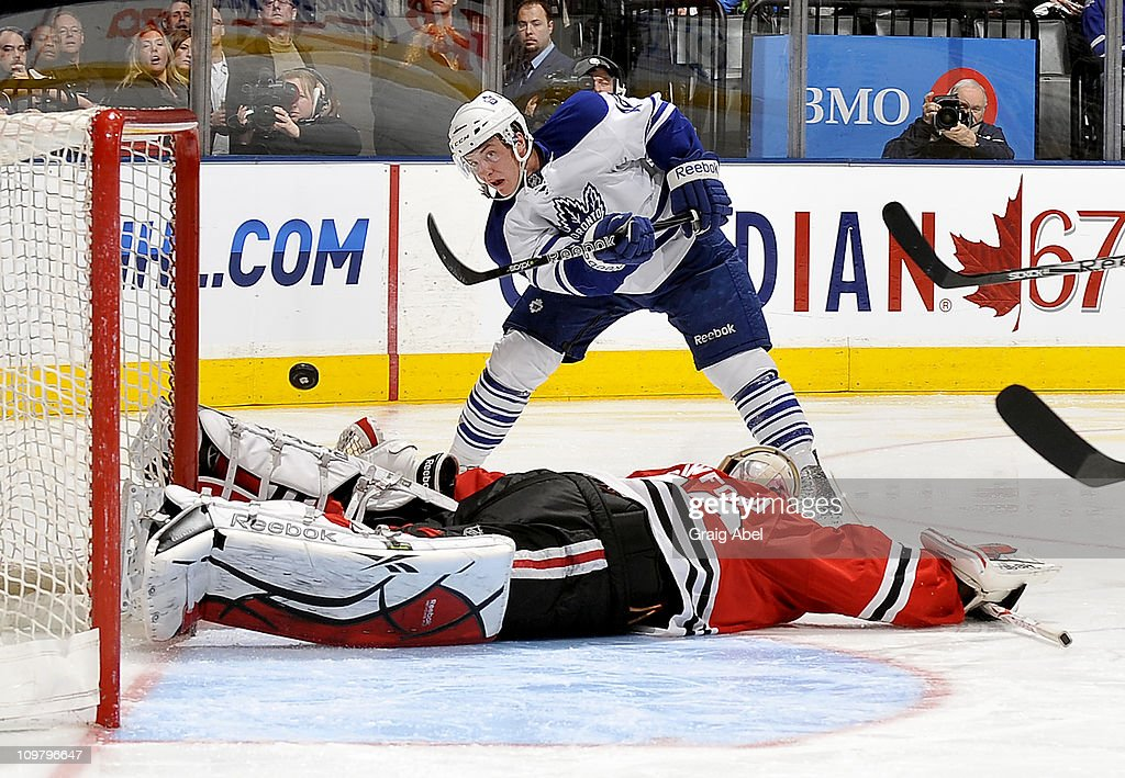 Tyler Bozak #42 of the Toronto Maple Leafs is stopped in close by Corey Crawford #50 of the Chicago Blackhawks March 5, 2011 at the Air Canada Centre in Toronto, Ontario, Canada.