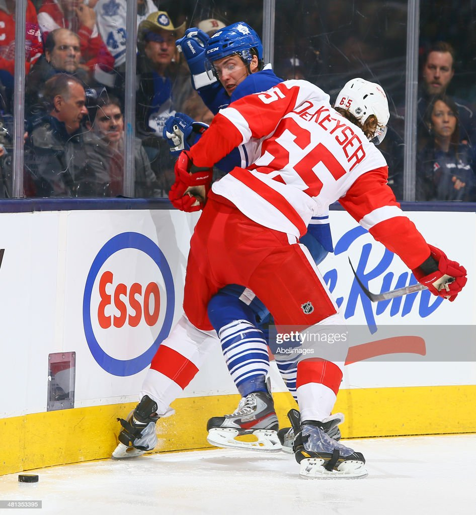 Tyler Bozak #42 of the Toronto Maple Leafs runs into Danny DeKeyser #65 of the Detroit Red Wings during NHL action at the Air Canada Centre March 29, 2014 in Toronto, Ontario, Canada.