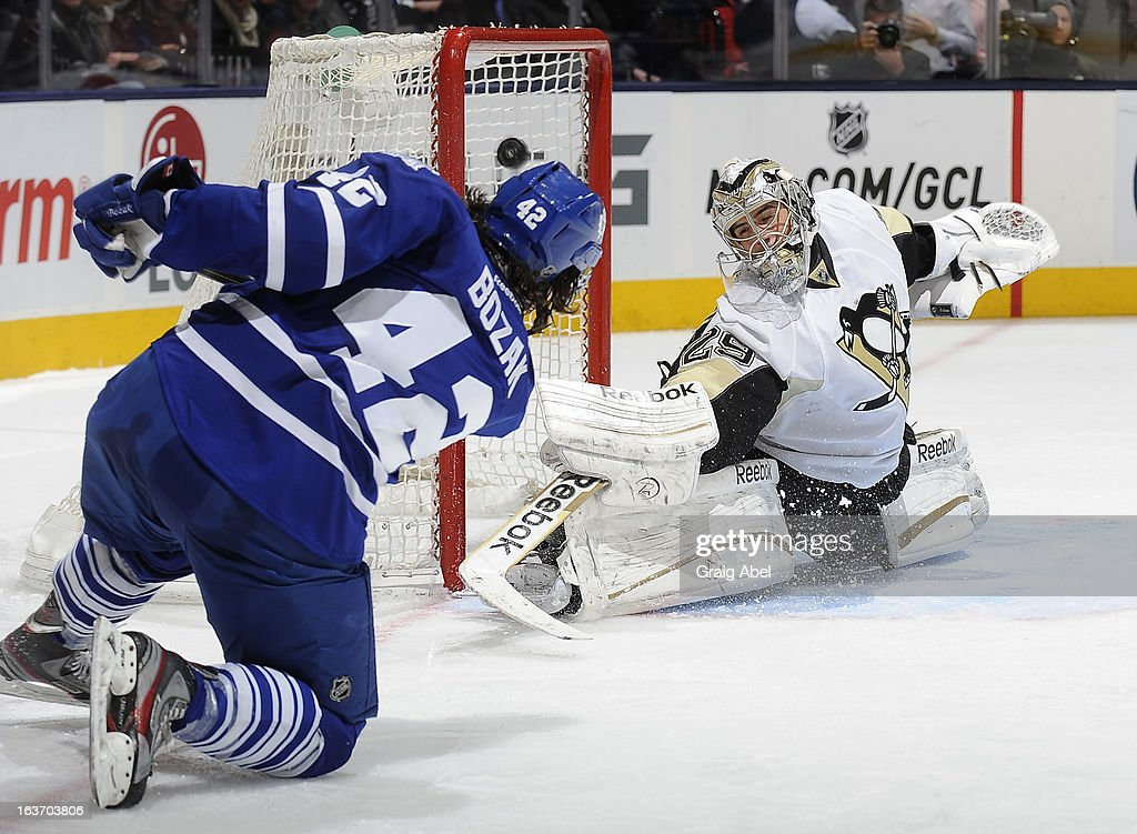 <a gi-track='captionPersonalityLinkClicked' href=/galleries/search?phrase=Tyler+Bozak&family=editorial&specificpeople=6183313 ng-click='$event.stopPropagation()'>Tyler Bozak</a> #42 of the Toronto Maple Leafs scores a second-period goal on <a gi-track='captionPersonalityLinkClicked' href=/galleries/search?phrase=Marc-Andre+Fleury&family=editorial&specificpeople=233779 ng-click='$event.stopPropagation()'>Marc-Andre Fleury</a> #29 of the Pittsburgh Penguins during NHL game action March 14, 2013 at the Air Canada Centre in Toronto, Ontario, Canada.