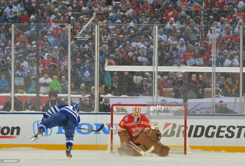 <a gi-track='captionPersonalityLinkClicked' href=/galleries/search?phrase=Tyler+Bozak&family=editorial&specificpeople=6183313 ng-click='$event.stopPropagation()'>Tyler Bozak</a> #42 of the Toronto Maple Leafs scores on goaltender Jimmy Howard #35 of the Detroit Red Wings during shootout overtime of the 2014 Bridgestone NHL Winter Classic on January 1, 2014 at Michigan Stadium in Ann Arbor, Michigan. Bozak's goal won the game in shootout overtime against the Detroit Red Wings. The Maple Leafs defeated the Red Wings 3-2 in shootout overtime.