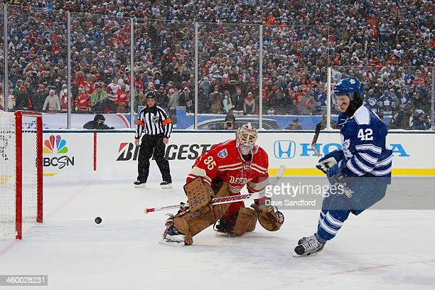 Tyler Bozak of the Toronto Maple Leafs scores on goaltender Jimmy Howard of the Detroit Red Wings during shootout overtime during the 2014...