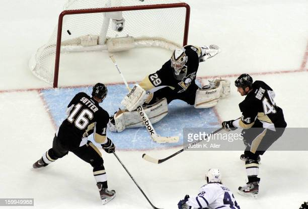Tyler Bozak of the Toronto Maple Leafs scores past MarcAndre Fleury of the Pittsburgh Penguins during the game at Consol Energy Center on January 23...